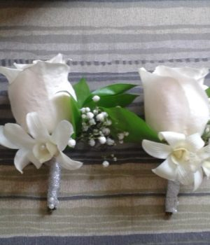 White boutonnieres wedding sxm flowers by flores