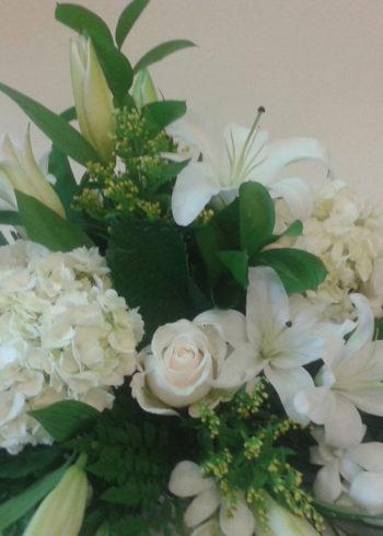 all-white-hydrangeas-oriental-lillies-and-dendrobium-centerpiece-sm