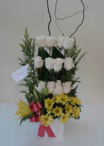 Birthday Exotic 12 White Roses arrangement with yellow daisies accents